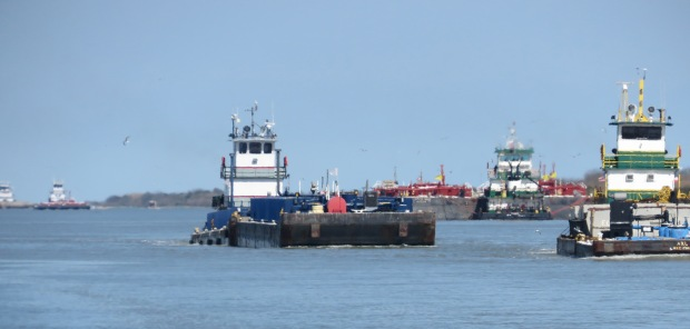 The constant stream of barges in the Intracoastal Waterway.