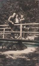 3 people on a bridge, 1937, Alaska