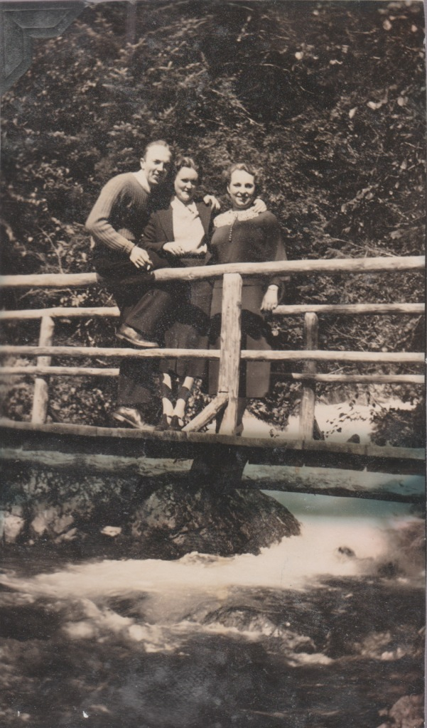 3 people on a bridge, 1937, Alaska
