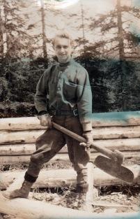 1932 man building cabin in Alaska